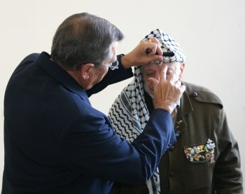 R.T. prays for President Arafat and anoints him with oil.