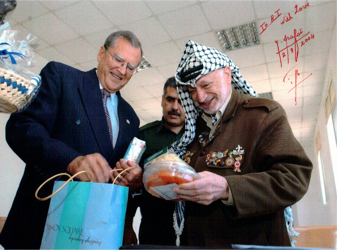 R.T. presents President Arafat with gifts for his 75th birthday.